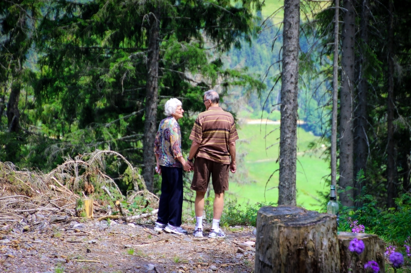 two-people-standing-in-forest-
